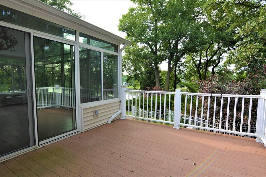 Real Estate Photography - 28812 W. Park Drive, Barrington, IL, 60010 - Private Deck off Four Season Sunroom and eating ar