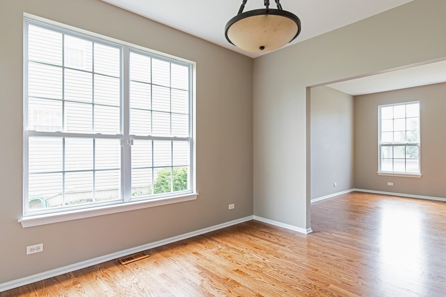 Real Estate Photography - 33 Bridlepath Drive, Lindenhurst, IL, 60046 - Dining Room & Living Room