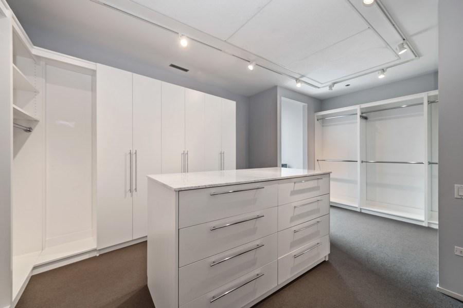Real Estate Photography - 30 W. OAK Street, Unit 11B, Chicago, IL, 60610 - Master Bedroom Walk-In Closet