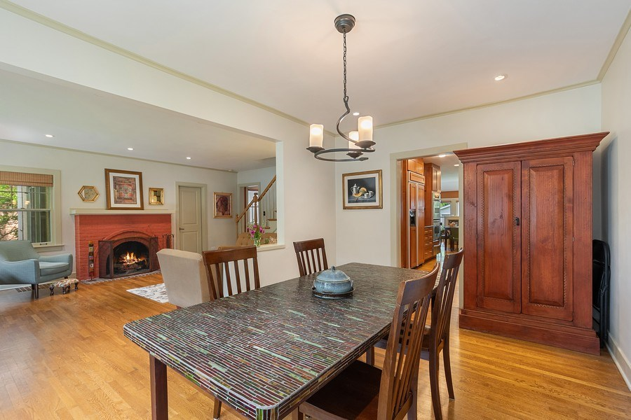 Real Estate Photography - 1927 Lincoln Street, Evanston, IL, 60201 - Dining Room with Fireplace View / Living Room
