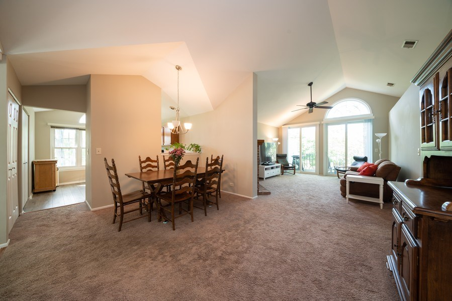 Real Estate Photography - 30W028 Juniper Court, Unit 028, Warrenville, IL, 60555 - Living Room / Dining Room