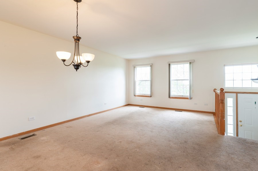 Real Estate Photography - 2563 North Augusta Dr, Wadsworth, IL, 60083 - Living Room / Dining Room