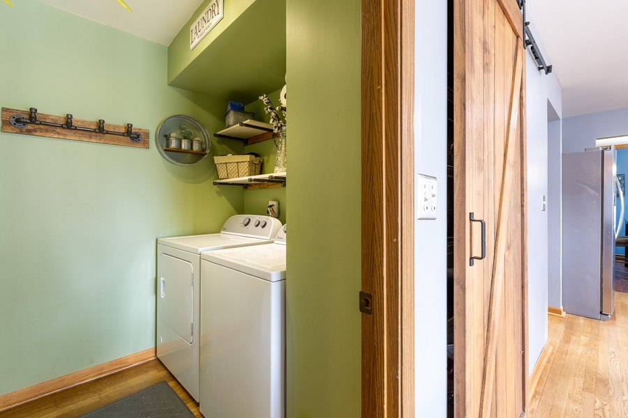 Real Estate Photography - 700 Auburn Ct, Crystal Lake, IL, 60014 - Laundry Room and Pantry with Custom Barn-door