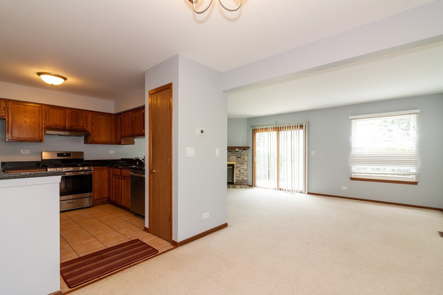 Real Estate Photography - 804 N. TAMARAC Boulevard, Addison, IL, 60101 - Kitchen / Living Room