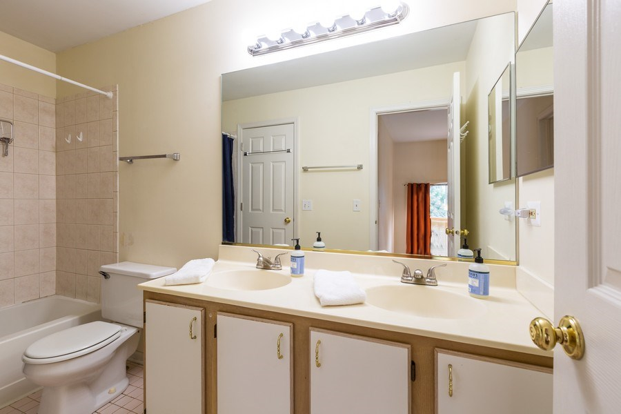 Real Estate Photography - 2269 N. Pheasant Ridge Court, Round Lake Beach, IL, 60073 - Master bath w/ceramic tile flr and double sink/van