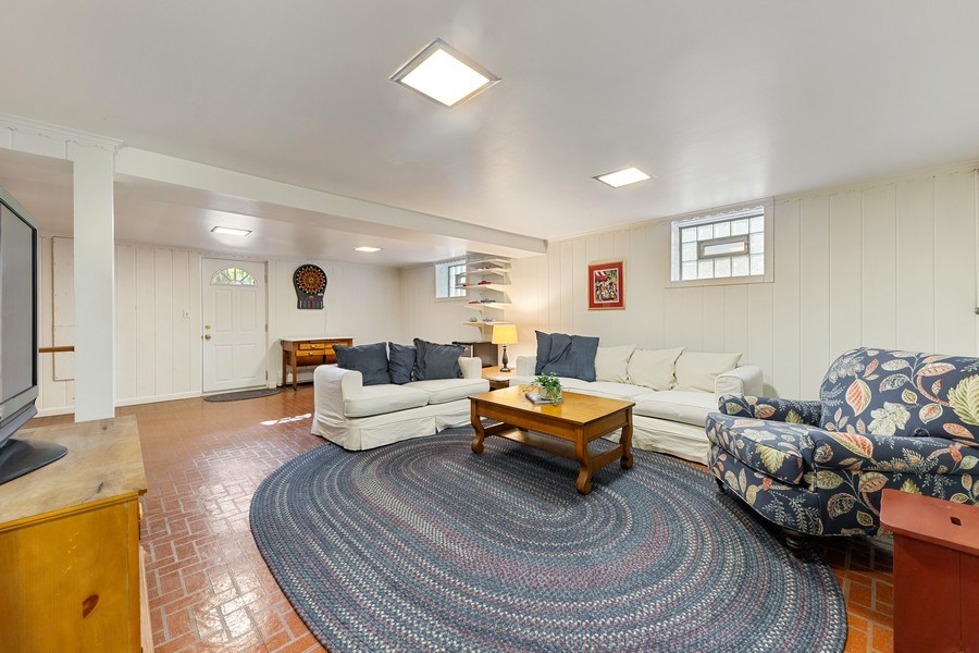 Real Estate Photography - 133 Barrypoint Rd, Riverside, IL, 60546 - Family Room - Basement