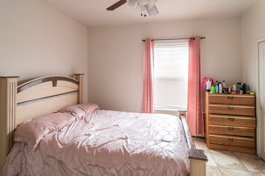 Real Estate Photography - 147 25TH Avenue, Bellwood, IL, 60104 - 1ST UNIT MASTER BEDROOM