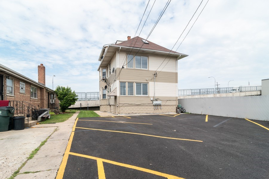 Real Estate Photography - 147 25TH Avenue, Bellwood, IL, 60104 - REAR VIEW & PARK LOT