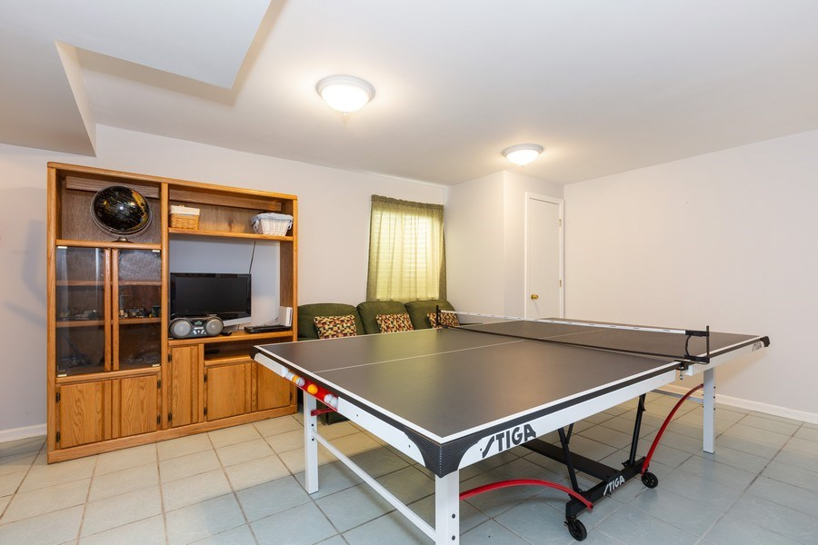 Real Estate Photography - 2135 Periwinkle Ln, Naperville, IL, 60540 - FINISHED BASEMENT REC ROOM