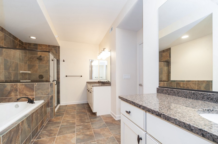 Real Estate Photography - 400 Village Green Pkwy, 304, Lincolnshire, IL, 60069 - Master Bathroom
