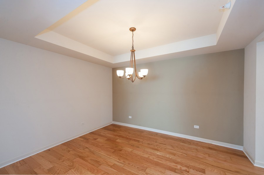 Real Estate Photography - 400 Village Green Pkwy, 304, Lincolnshire, IL, 60069 - Dining Room