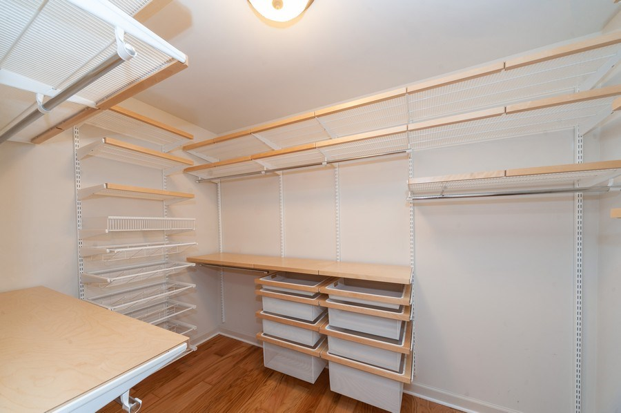 Real Estate Photography - 400 Village Green Pkwy, 304, Lincolnshire, IL, 60069 - Master Bedroom Closet