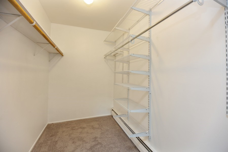 Real Estate Photography - 2431 East Brandenberry Ct, 1R, Arlington Heights, IL, 60004 - Master Bedroom Closet