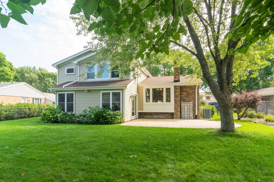 Real Estate Photography - 3039 North Huntington Dr, Arlington Heights, IL, 60004 - Rear View-Addition w/sliders to large brick patio