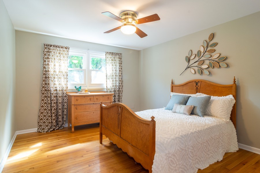 Real Estate Photography - 3039 North Huntington Dr, Arlington Heights, IL, 60004 - 3rd Bedroom featuring hardwood floors & fan
