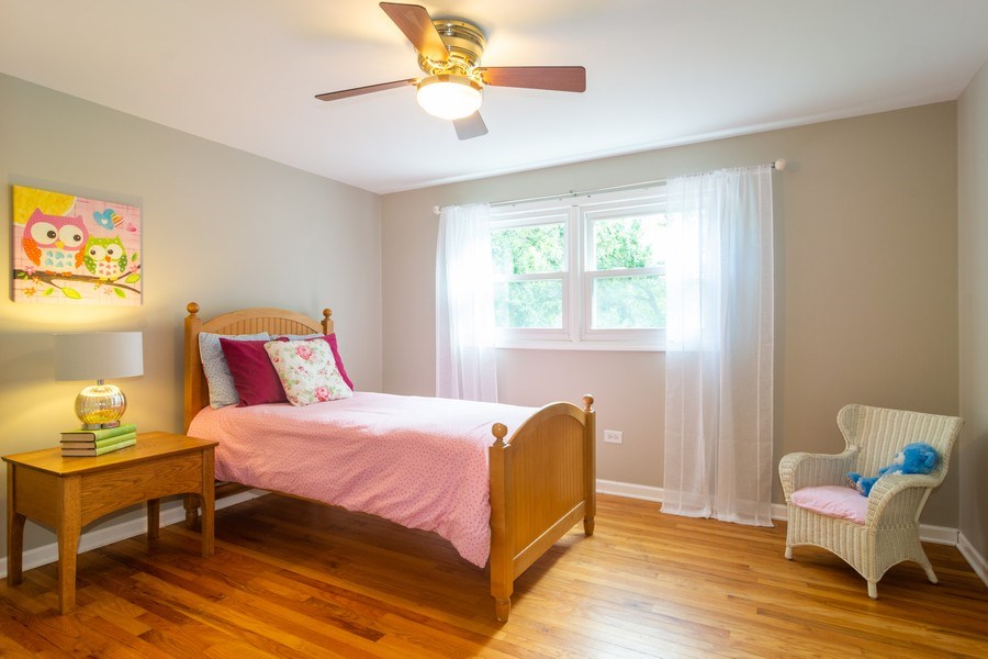 Real Estate Photography - 3039 North Huntington Dr, Arlington Heights, IL, 60004 - 2nd Bedroom featuring hardwood floors & fan