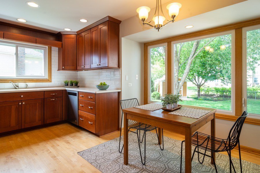 Real Estate Photography - 3039 North Huntington Dr, Arlington Heights, IL, 60004 - Kitchen eating area offers pretty yard views
