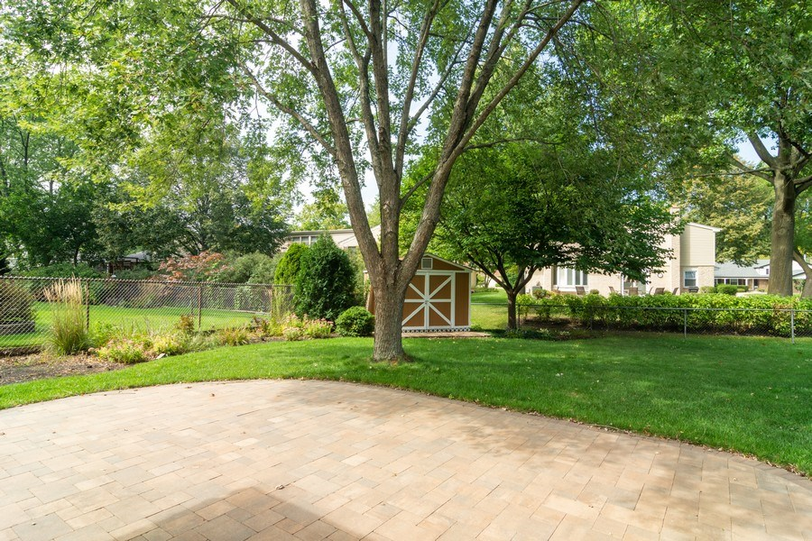 Real Estate Photography - 3039 North Huntington Dr, Arlington Heights, IL, 60004 - Patio overlooks lovely fenced yard