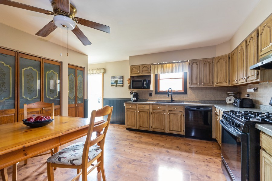 Real Estate Photography - 10281 West Talmadge Ave, Beach Park, IL, 60087 - Kitchen / Breakfast Room