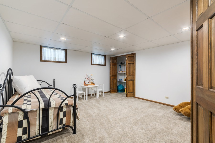 Real Estate Photography - 914 Monticello Dr, Naperville, IL, 60563 - Play room or guest BR