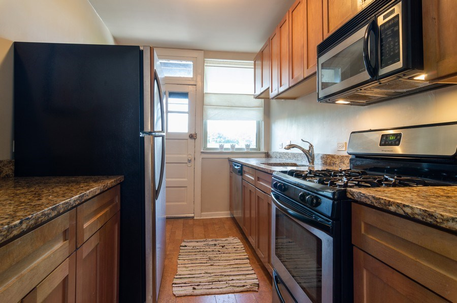 Real Estate Photography - 4130 North Kedvale Ave, 308, Chicago, IL, 60641 - Kitchen