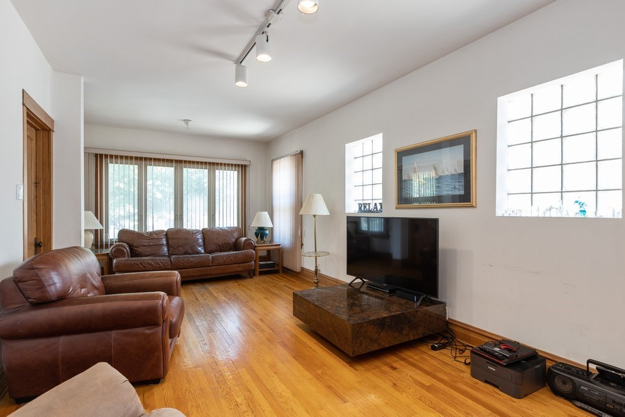 Real Estate Photography - 4865 West Addison St, Chicago, IL, 60641 - Living Room