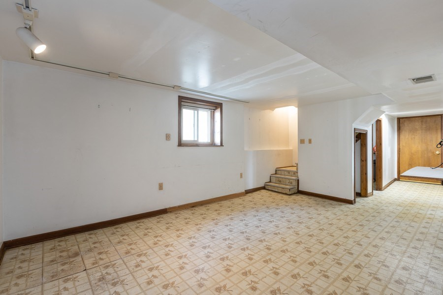 Real Estate Photography - 4865 West Addison St, Chicago, IL, 60641 - Lower Level