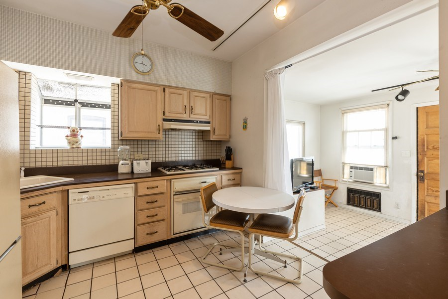 Real Estate Photography - 4865 West Addison St, Chicago, IL, 60641 - Kitchen