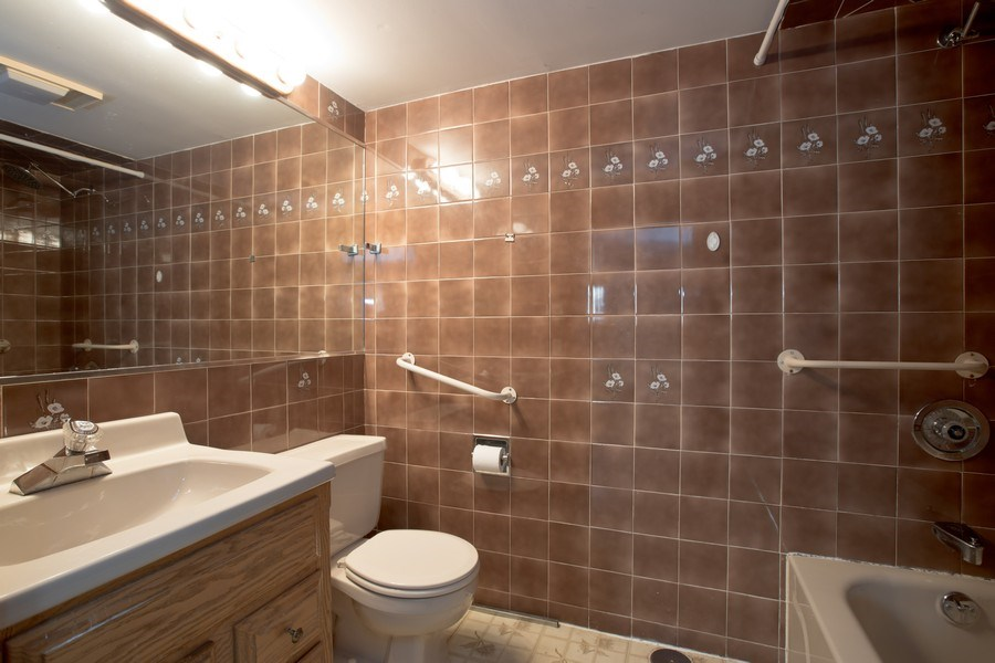 Real Estate Photography - 4865 West Addison St, Chicago, IL, 60641 - Bathroom