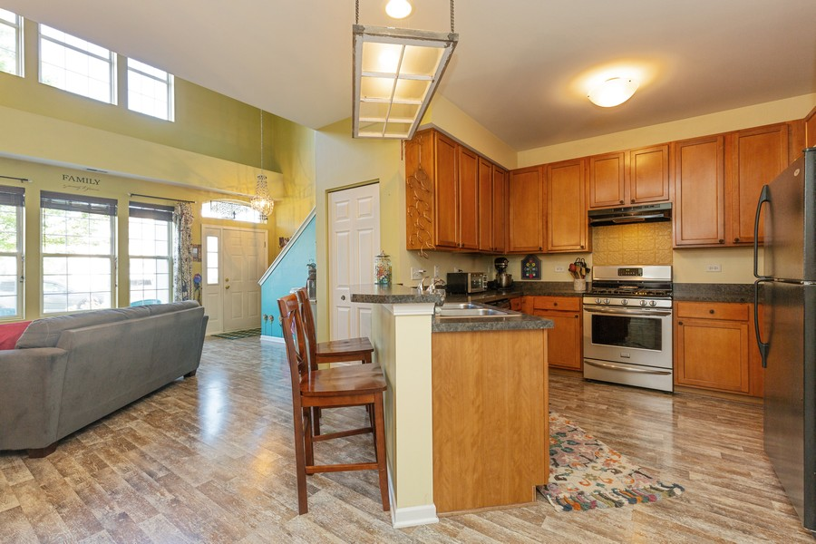 Real Estate Photography - 1890 Sebastian Dr, 0, Woodstock, IL, 60098 - KITCHEN--Wide open views of Living Room!