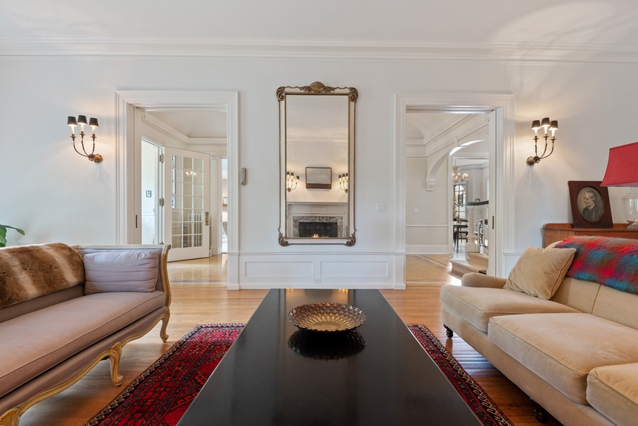 Real Estate Photography - 1128 Ridge Ave, Evanston, IL, 60202 - Living Room with Double Pocket Doors
