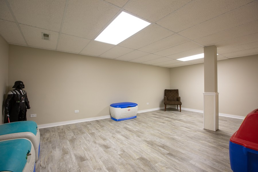 Real Estate Photography - 6S222 New Castle Rd, Naperville, IL, 60540 - Finished Basement Area