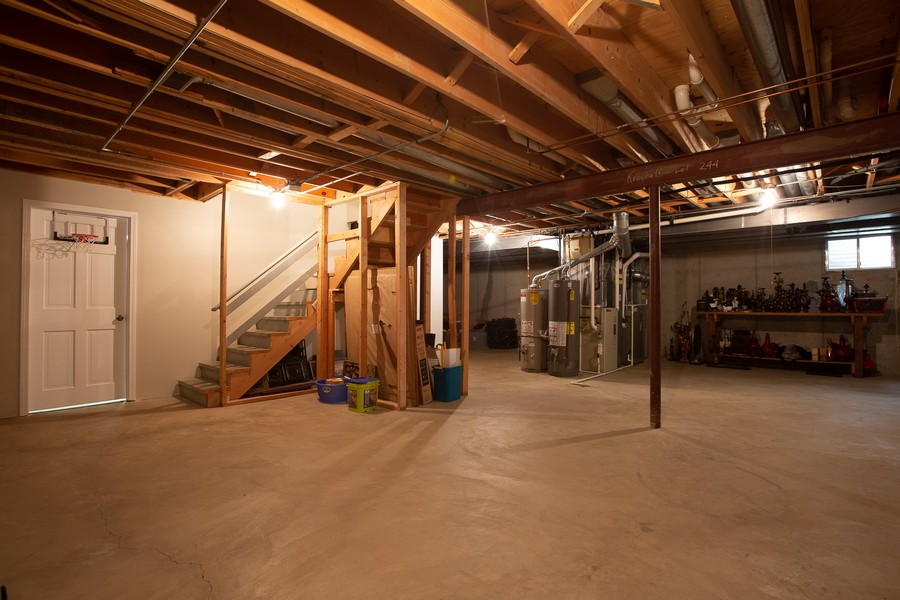 Real Estate Photography - 6S222 New Castle Rd, Naperville, IL, 60540 - Unfinished Basement Storage Area