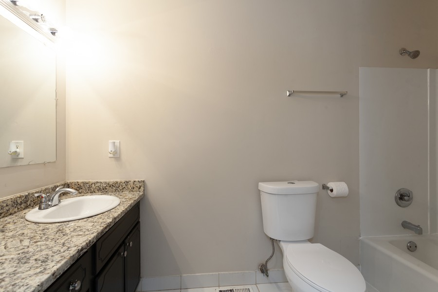 Real Estate Photography - 703 Wildwood Ln, Streamwood, IL, 60107 - Bathroom