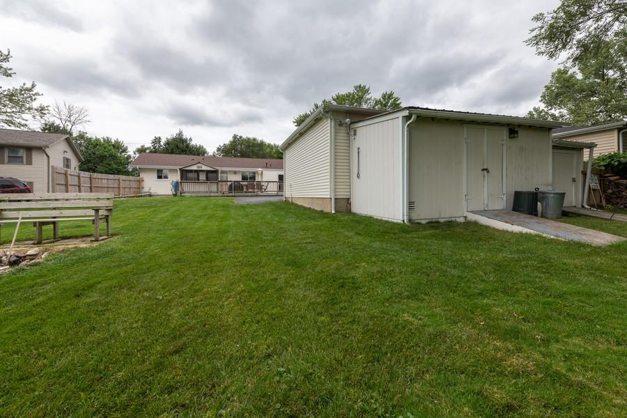 Real Estate Photography - 1818 Hazelwood Dr, Lindenhurst, IL, 60046 - Two sheds behind garage