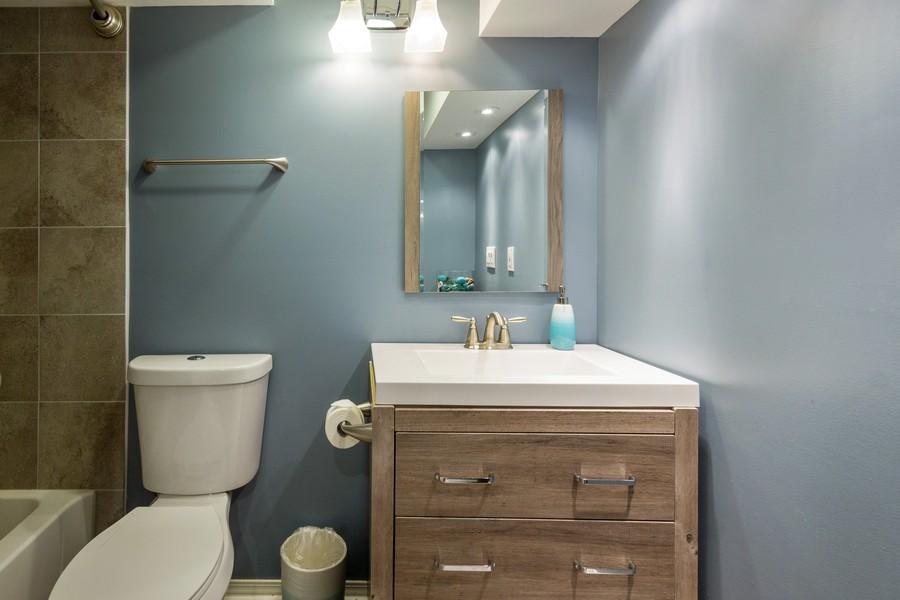 Real Estate Photography - 2947 Church Rd, Aurora, IL, 60502 - Basement Bath