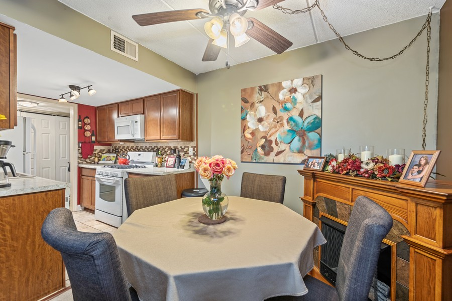 Real Estate Photography - 502 Redondo Dr, 106, Downers Grove, IL, 60516 - Dining Room