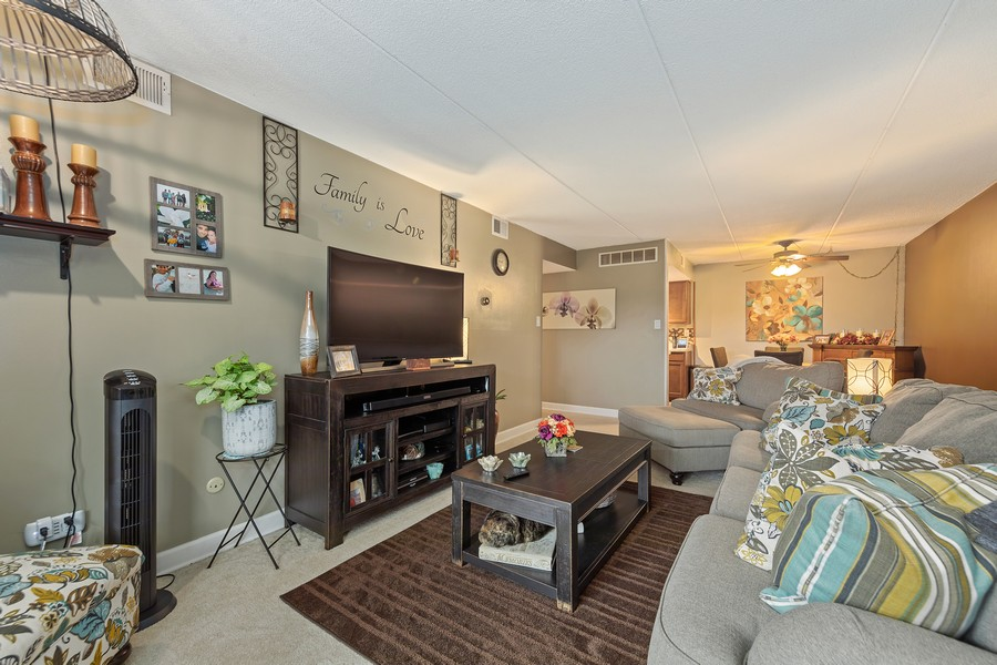 Real Estate Photography - 502 Redondo Dr, 106, Downers Grove, IL, 60516 - Living Room / Dining Room