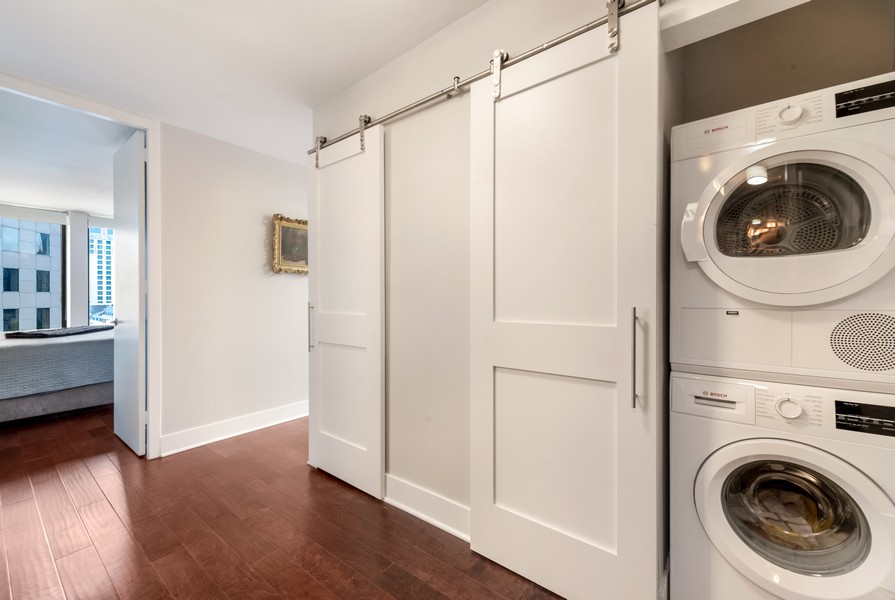 Real Estate Photography - 100 East Walton St, 21D, Chicago, IL, 60611 - Laundry Room