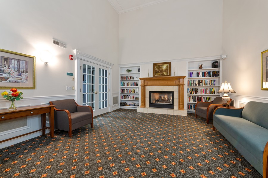Real Estate Photography - 1220 Depot St, 416, Glenview, IL, 60025 - Library