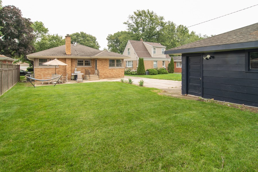 Real Estate Photography - 1434 Boeger Ave, Westchester, IL, 60154 - Spacious Back Yard & 2-Car Garage