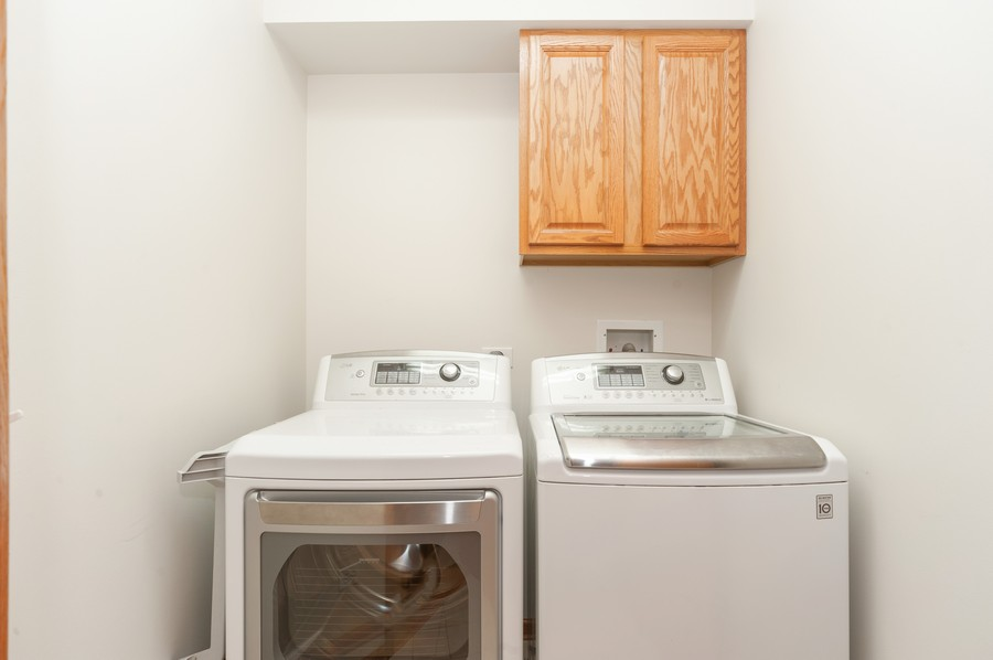 Real Estate Photography - 200 West Campbell St, 609, Arlington Heights, IL, 60005 - Laundry Room