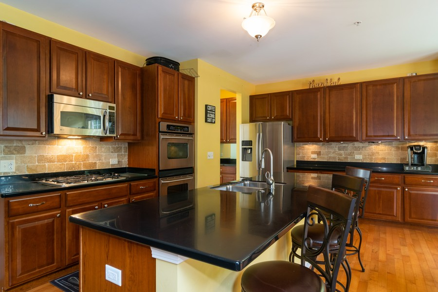 Real Estate Photography - 1394 Essex Dr, Hoffman Estates, IL, 60192 - Kitchen