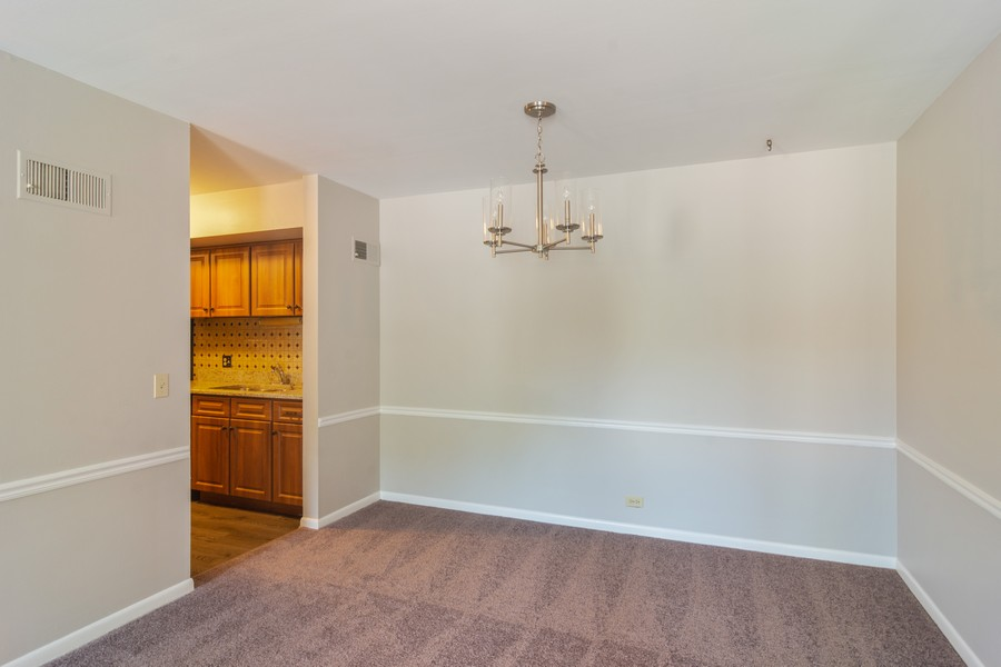 Real Estate Photography - 550 Shorely Dr, 204, Barrington, IL, 60010 - Dining Room