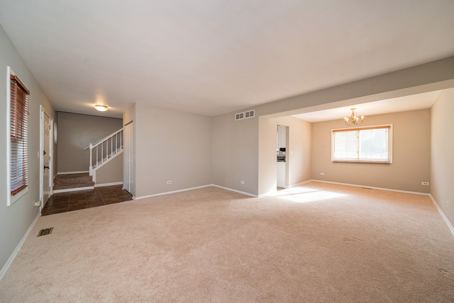 Real Estate Photography - 1399 Loch Lomond Dr, Crystal Lake, IL, 60014 - Living Room / Dining Room