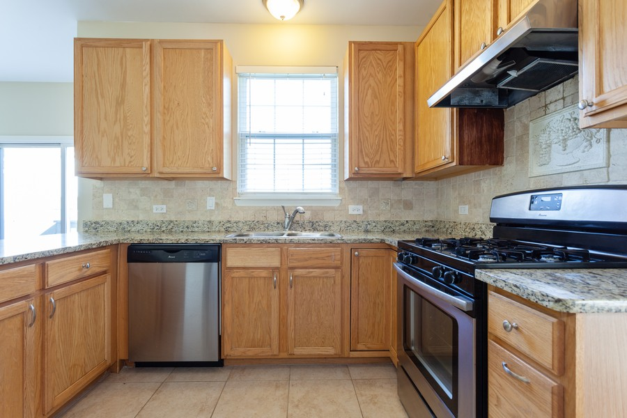 Real Estate Photography - 763 Sapphire Dr, Bolingbrook, IL, 60490 - Kitchen