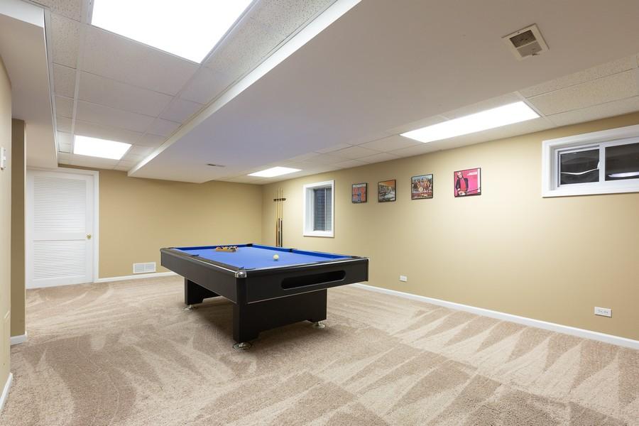 Real Estate Photography - 3011 Bennett Dr, Naperville, IL, 60564 - Finished Basement Rec Room