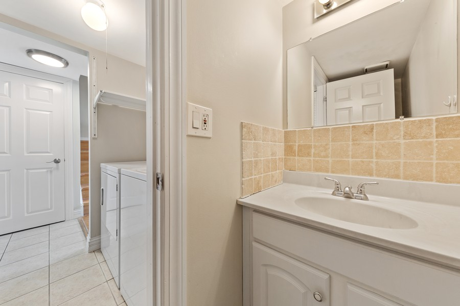 Real Estate Photography - 330 Rodenburg Rd, Roselle, IL, 60172 - Powder Room