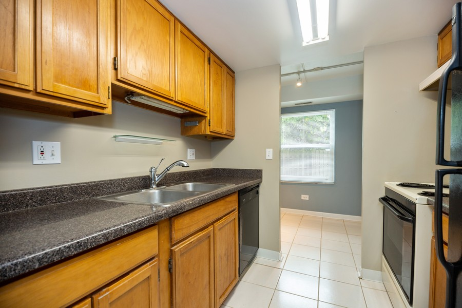 Real Estate Photography - 812 North River Rd, 1C, Mount Prospect, IL, 60056 - Kitchen