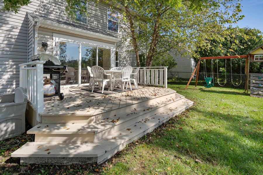 Real Estate Photography - 203 Heritage Trl, Hainesville, IL, 60030 - Deck